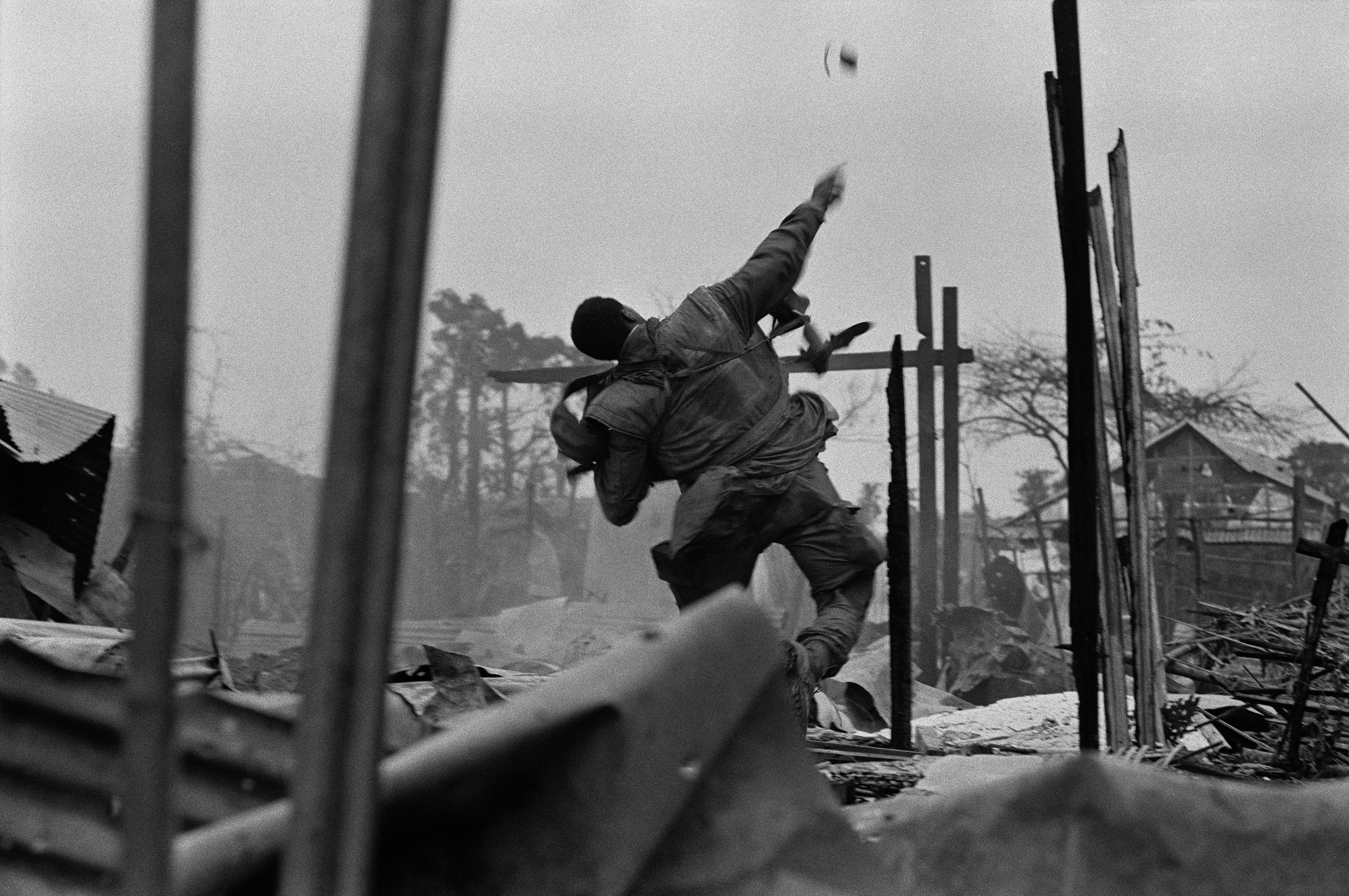 US Marine hurling grenade, Hue, 1968 © Don McCullin, Courtesy Hamiltons Gallery, London, and Folia Gallery, Paris.